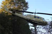 65-9770 - UH-1 on post along Hwy 231 in Ozark Alabama - by Florida Metal