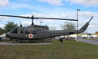 69-15171 @ VPS - UH-1H Iroquois in front of the Ft. Walton Beach Airport terminal