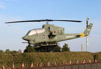 159226 - AH-1J Sea Cobra on a Veterans wall Pensacola FL