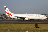 VH-VOQ @ YSSY - taxiing from 34R - by Bill Mallinson