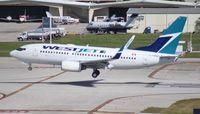 C-FWAD @ FLL - West Jet 737-700