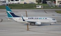 C-GWJK @ FLL - West Jet 737-700 - by Florida Metal