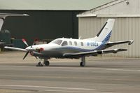 M-USCA @ EGBJ - Socata TBM 850 at Gloucestershire Airport on Day 1 of the 2014 Cheltenham Horse Racing Festival - by Terry Fletcher