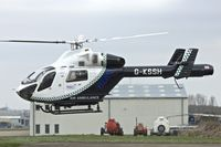G-KSSH @ EGBJ - MD-900 Explorer at Gloucestershire Airport on Day 1 of the 2014 Cheltenham Horse Racing Festival