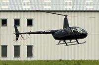 G-OHAM @ EGBJ - 2005 Robinson R44 Raven II, c/n: 10743