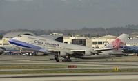 B-18207 @ KLAX - Departing LAX on 25R - by Todd Royer