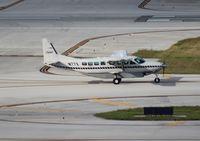 N77X @ LAL - Cessna 208B