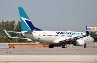 C-GWBJ @ KFLL - Westair B737 lining-up - by FerryPNL