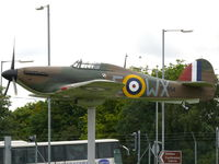 BAPC267 @ EGSU - This plastic Hurricane guards the gates at Duxford - by Alex Smit