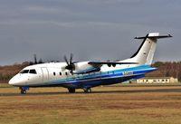 D-CAAH @ EGHH - ex 5N-SAG to be N941EF for Sierra Nevada Corpn and USAF - by John Coates