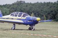 100 @ LFFQ - F-SEXQ taxiing after landing at La Ferté-Alais, 2004 airshow, as n° 2 of the Armée de l'Air patrouille Cartouche Dorée (GE-315). - by J-F GUEGUIN