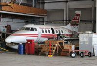 N339TE @ YIP - Ex TWExpress Jetstream sitting in a hangar at YIP