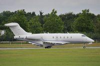 N300GP @ EGLF - Taxiing to depart - by John Coates