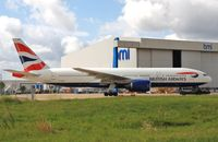 G-YMMT @ EGLL - Towed to stand - by John Coates