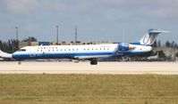 N521LR @ MIA - United Express CRJ-700