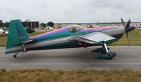 N540WS @ LAL - Bill Stein Aerosports Edge 540 changes from purple to green as it moves by