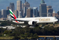 A6-ECR @ SYD - Emirates B777-300 on approach to Sydney with the city skyline in the bakground - by mt334