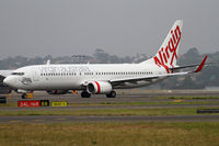 VH-YIL @ YSSY - taxiing from 16R - by Bill Mallinson