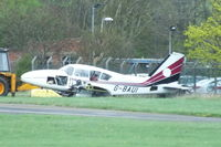 G-BAUI @ EGBJ - dumped on the edge of the airfield - by Chris Hall