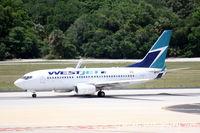 C-GWJO @ KTPA - West Jet Flight 1245 (C-GWJO) departs Tampa International Airport enroute to Toronto Pearson International Airport - by Donten Photography