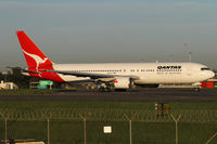 VH-OGI @ YSSY - taxiing from 34R - by Bill Mallinson