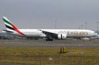A6-ECU @ YSSY - taxiing off 34L - by Bill Mallinson