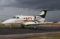 N999TN @ LAL - Phenom 100 with approaching storm