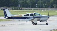 N6038Q @ ORL - Beech F33A Bonanza