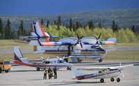 C-GHWF @ CYXY - On the ramp at Whitehorse, Yukon, en route to Alaska to help fight the Funny River fire. - by Murray Lundberg