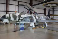 N64274 @ TIX - T-33 under restoration at Valiant Air Command