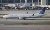 N73406 @ MIA - United 737-900