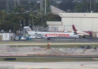 YV1111 @ FLL - Rare in the US, had to shoot bad record shot from across the ramp - Conviasa Venezuela CRJ-700