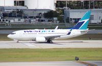 C-FWAD @ FLL - West Jet 737-700 - by Florida Metal