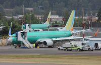 A6-FEN @ KRNT - Boeing 737-800 - by Mark Pasqualino