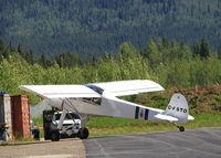 C-FSTO @ CYDA - Arriving back at Dawson City, Yukon, after a flight. - by Murray Lundberg
