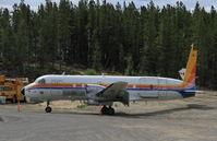 C-GANA @ CYXY - Beside Air North's rear maintenance hangar at Whitehorse, Yukon. - by Murray Lundberg