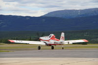 C-GSYF @ CYXY - Taxiing from the fire tanker base at Whitehorse, Yukon. - by Murray Lundberg