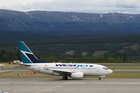 C-GPWS @ CYXY - Taxiing to the terminal at Whitehorse, Yukon. - by Murray Lundberg