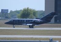 N733JB @ ORL - Falcon 20