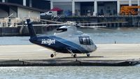 C-FZAA @ CBC7 - Helijet nearing departure from Vancouver Harbour Heliport. - by M.L. Jacobs