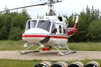 C-FALV @ CYOP - On standby for forest fire detail in Rainbow Lake, Alberta - by Guy Pambrun