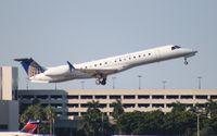 N13202 @ PBI - United Express E145XR