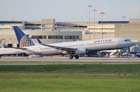 N35407 @ PBI - United 737-900