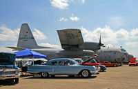 69-6580 @ KDOV - A very nice 1969 Hercules towers over a sea of classic cars. - by Daniel L. Berek
