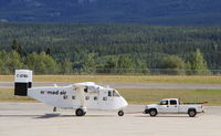 C-GTBU @ CYXY - Being towed back to the Nomad Air base at Whitehorse, Yukon. - by Murray Lundberg