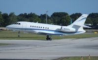 N303CL @ ORL - Falcon 2000