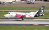 N304AG @ TPA - Silver Saab 340