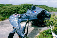 XS529 @ EGDO - Scanned from print. Ex 829 NAS Wasp HAS.1 XS529 remains lying at RNAS Predannack, Cornwall (EGDO) in July '97.  Previously based on HMS Tartar and HMS Galatea - by Clive Pattle