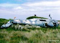 XP160 @ EGDO - Scanned from print. Remains of Wessex HAS.1 XP160 at the fire training school, RNAS Predannack (EGDO). Ex School of Aircraft Handling at nearby Culdrose, with the code SAH-24 - by Clive Pattle