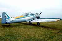 F-WJBI @ LFFQ - North American AT-6C Harvard IIa [88-12127] La Ferte Alais~F 16/09/1978. From a slide.